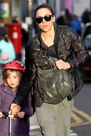 Mel C looked cozy in a brown puffer jacket while strolling with her daughter.