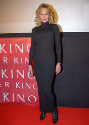 Melanie Griffith flaunted her ageless figure in a body-con turtleneck sweater dress while visiting Lugner Kino City.