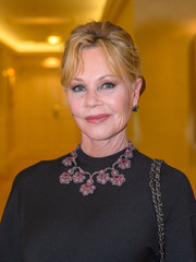 Melanie Griffith dolled up her black dress with a pink and red gemstone statement necklace.