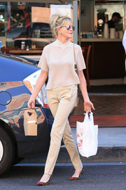 Melanie Griffith styled her outfit with a pair of Christian Louboutin kitten heels, in leopard print with red toe caps.