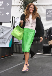 Kelly Bensimon brightened up in a sequined lime green pencil skirt.