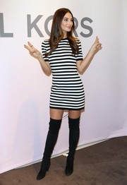 Lily Aldridge punched up her look with a pair of black suede over-the-knee boots by Stuart Weitzman.