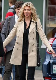 Alyson wears a classic trench on the set of the new cheerleading drama 'Hellcats.'