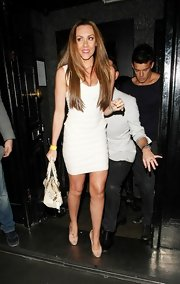 Michelle Heaton left the Anaya Club wearing a white bandage dress.