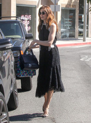 A stylish black leather tote rounded out Michelle Monaghan's ensemble.