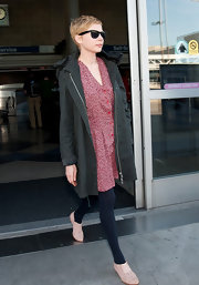Michelle Williams looked cute and casual in this red floral dress while arriving at LAX.