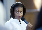 Michelle Obama had a retro aura about her with this teased bob during a visit to Oxford University.