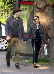 Mila mixed textures when she wore this pair of black leather pants with a tweed jacket.