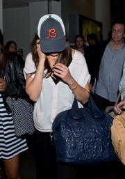 Mila Kunis kept a low profile with a Chicago Bears cap.