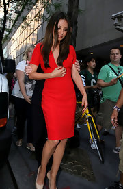 Mila Kunis looked red hot for her visit to the 'Today Show' wearing a chic red short-sleeve day dress. Mila kept the rest of her look simple with champagne heels and straight brown locks.