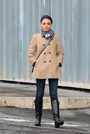 Mila Kunis kept warm in style in this tan wool coat while out shopping.