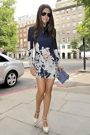 Mila Kunis channeled '60s mod in a mini floral sheath dress and t-strap mary janes, perfect for her romp around London. The long-sleeve Cacharel mini was teamed with white platform Elie Saab heels and a lilac quilted leather Chanel clutch. This sweet retro look certainly makes us crave at trip across the pond!