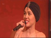 Miley Cyrus looked exotic wearing this embellished black turban on 'The X Factor' UK.
