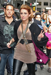 Miley loves to accessorize her look with loads of necklaces. She topped off her rockin' look with gold-and-silver chain necklaces.