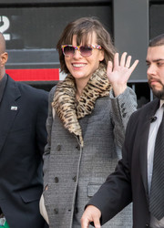 Milla Jovovich kept it fun with a pair of multicolored sunglasses while headed to 'Jimmy Kimmel Live.'