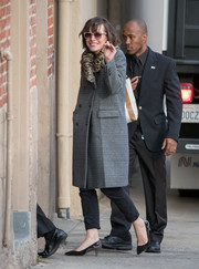 Milla Jovovich headed to 'Jimmy Kimmel Live' wearing a glen plaid coat with a leopard-print collar.