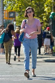Milla spiced up her casual look with a baby pink sheer tee.
