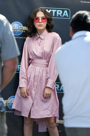Millie Bobby Brown looked effortlessly chic in this belted pink shirtdress by Sies Marjan while visiting 'Extra.'