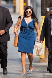 Mindy Kaling arrived for her 'Jimmy Kimmel Live' appearance wearing a curve-hugging blue dress with an embellished neckline and waistband.