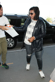 Mindy Kaling took a flight out of LAX wearing a stylish black leather jacket.