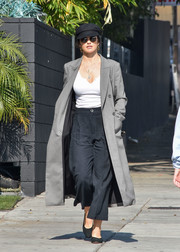 Minka Kelly topped off her outfit with a gray coat.
