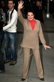Liza Minnelli waved to her New York fans as she was caught on cam walking around town wearing a casual suit.