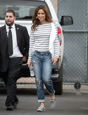 Minnie Driver went grungy on the bottom half in a pair of ripped boyfriend jeans.
