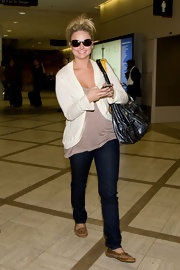 Miranda Lambert kept her travel attire casual with a pair of tan suede moccasins.