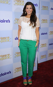 Ali Landry attended the world premiere of 'Mirror Mirror' wearing a strappy pair of green and blue sandals.
