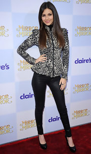 "Victoria Justice attended the World Premiere of ""Mirror Mirror"" at Grauman's Chinese Theatre wearing this animal print zip-up jacket."