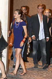 Charlotte showed off her svelte figure in a simple navy blue dress, accessorized with bold and colorful jewelry.