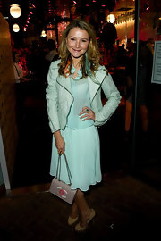 Amber Atherton maintained her pastel style with a taupe chain strap purse with a pink logo.
