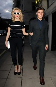 Pixie Lott stuck to the theme of black and white with a matching top and pant set.