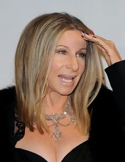 Barbra Streisand glammed it up with an exquisite diamond chandelier necklace at the MusiCares 2011 tribute.