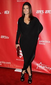 Gina Gershon hid her famous curves in a loose black evening dress at the 2013 MusiCares Person of the Year Tribute.