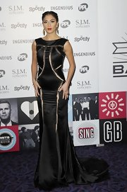 Nicole went for another goth look in this black Elvira gown at the Trust Awards.