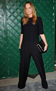 Stella McCartney wore all black except for the white border of her clutch to the premiere of her father's music video.