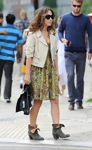 Myleen Klass mixed feminine prints with a cropped moto jacket while dropping her kids off at school.