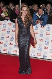 Michelle Heaton set aside all her workout gear and wore a glamorous glitter dress for the National Television Awards.