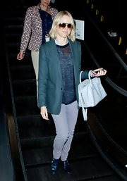 Naomi Watts channeled the '80s with this cool teal blazer while out in LA.