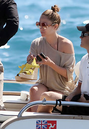 Jennifer rocked a different pair of designer shades every day during her Cannes visit. The singer kept it casual and sported a messy bun with oversized orange shades while boating with her family.