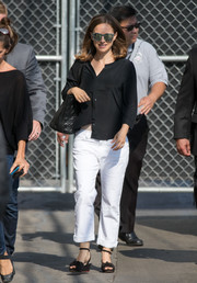 For her shoes, Natalie Portman chose a pair of low black wedges.