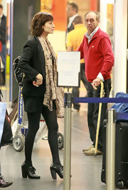 Natalie Imbruglia caught a flight from Milan wearing a comfy pair of black brogues.