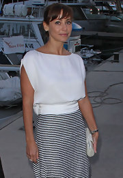 Natalie Imbruglia sported a chic nautical look with this loose white blouse and striped skirt combo at Cannes.