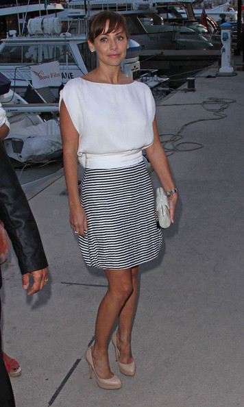 Natalie Imbruglia paired a striped mini skirt with a white blouse for an event in Cannes.