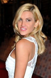 Ashley wore her hair in loose, glamorous curls in a side-part, adding to her classic look.