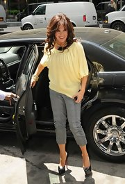 These platform pumps with their sky-high heels were a bold choice for Marie Osmond in this concrete jungle.