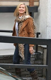 Olivia Newton-John wrapped her neck with a leopard-print scarf while out at the London Studios.