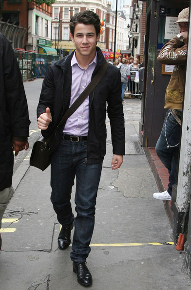The squeaky-clean popstar wore dark jeans with polished leather lace-ups.