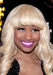 For a visit to Seine Studios, Nicki Minaj wore a great grape shade of glossy lipstick.
